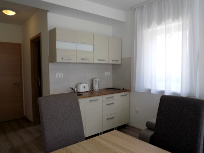 In Balatonlelle, 150 meters from Lake Balaton a ground floor apartment in a newly built apartment building is available for 2+3 people
